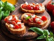 Приготвяне на рецепта Брускети сандвичи от бегета с моцарела, чери домати и босилек на фурна